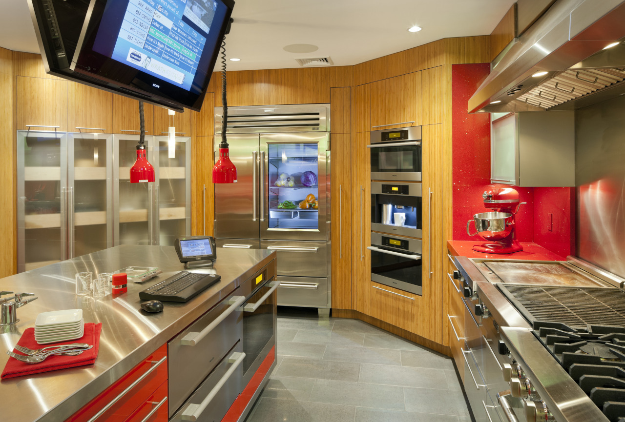 Cabinets in this test kitchen feature a mix countertop, interior design, kitchen, real estate, orange, brown