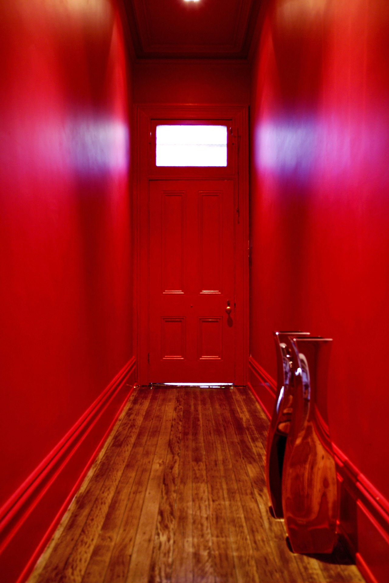 A lively palette of Resene colours has transformed floor, flooring, interior design, light, lighting, red, room, wood, red