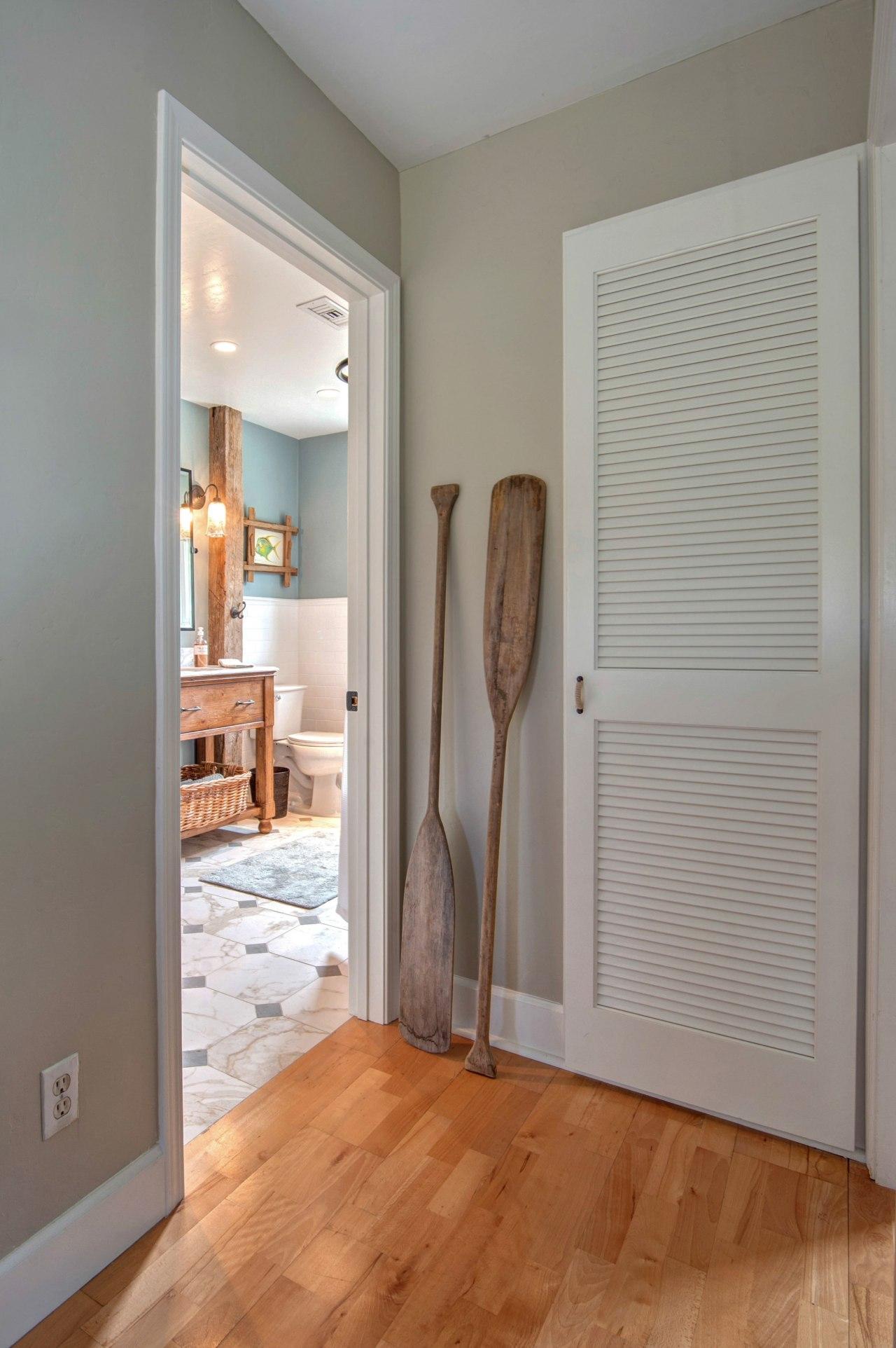 This modest guest bathroom celebrates a relaxed seaside ceiling, door, floor, flooring, hardwood, home, interior design, laminate flooring, molding, real estate, room, wall, window, window covering, wood, wood flooring, gray