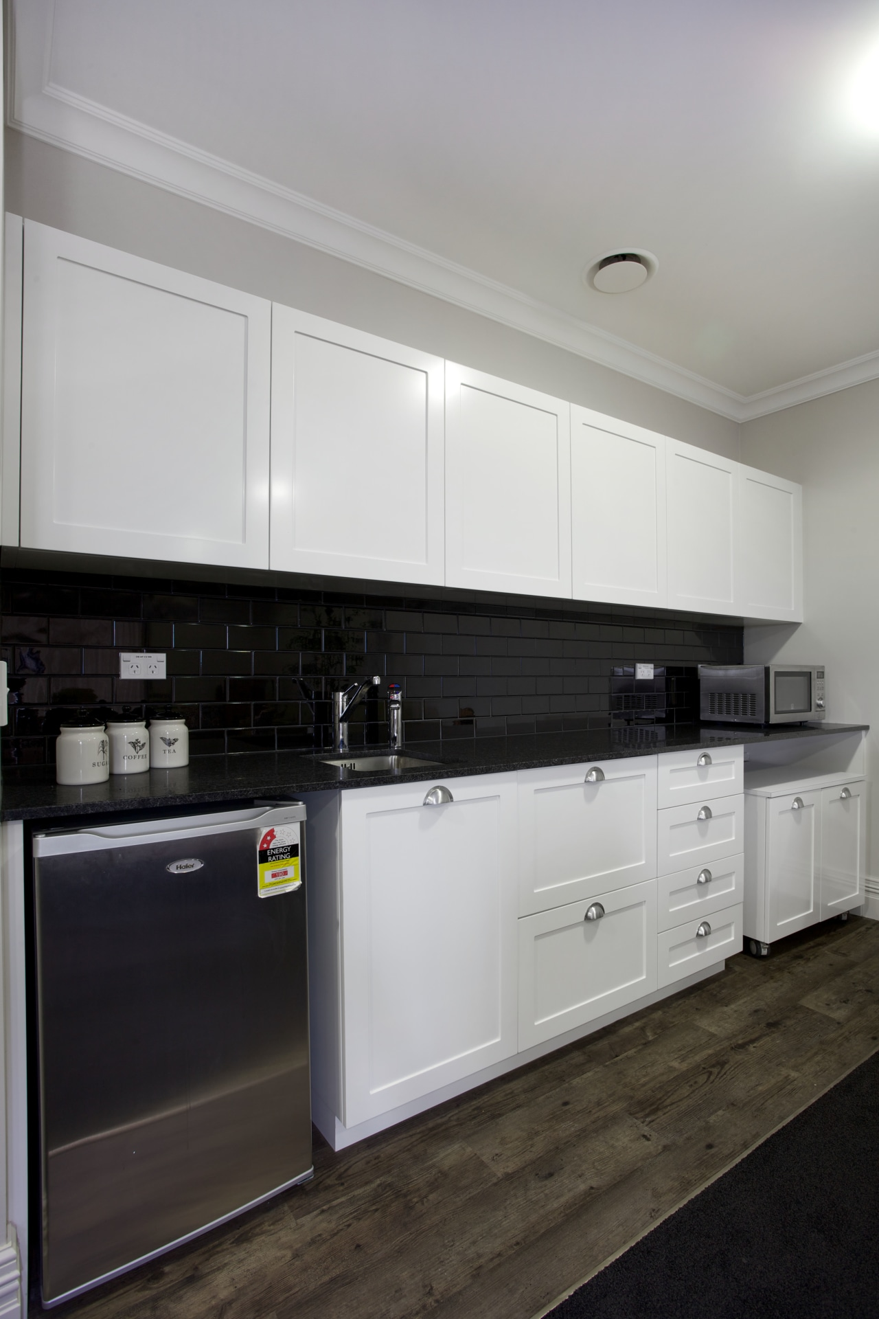 White limante kitchen with stainless steel appliances cabinetry, countertop, cuisine classique, interior design, kitchen, kitchen stove, room, gray, black