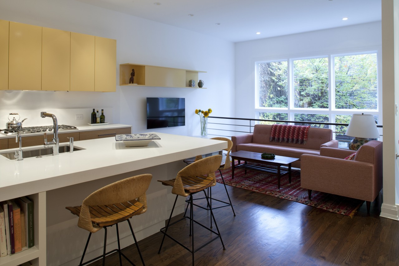 In this kitchen by architect William Massey, while countertop, floor, flooring, interior design, kitchen, living room, real estate, room, table