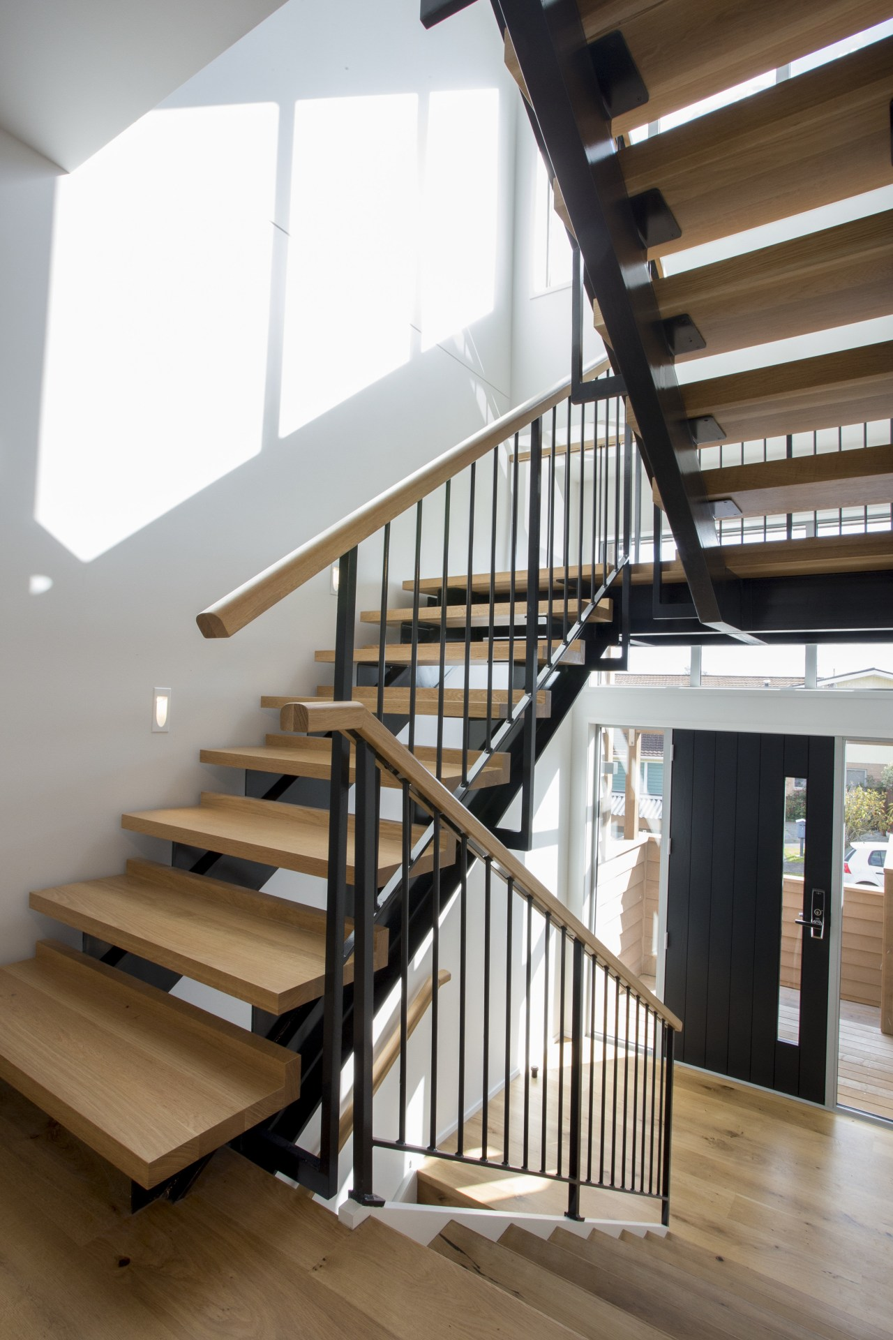 Riderless steel stairs with blond wood treads and baluster, daylighting, floor, handrail, home, house, interior design, stairs, structure, wood, brown, gray