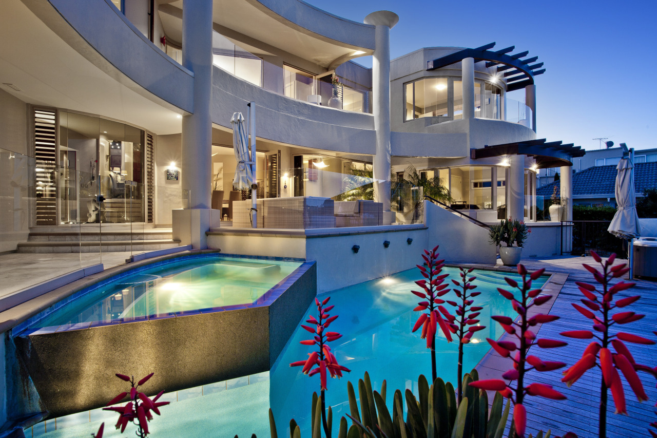 Water cascades down from an infinity edge pool, estate, home, hotel, leisure, leisure centre, property, real estate, resort, resort town, swimming pool, water