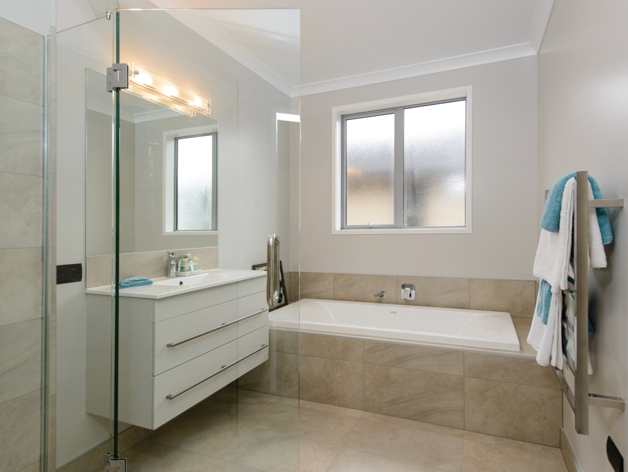 GJ Gardner Homes show home bathroom bathroom, bathroom accessory, bathroom cabinet, floor, home, interior design, real estate, room, sink, tile, gray