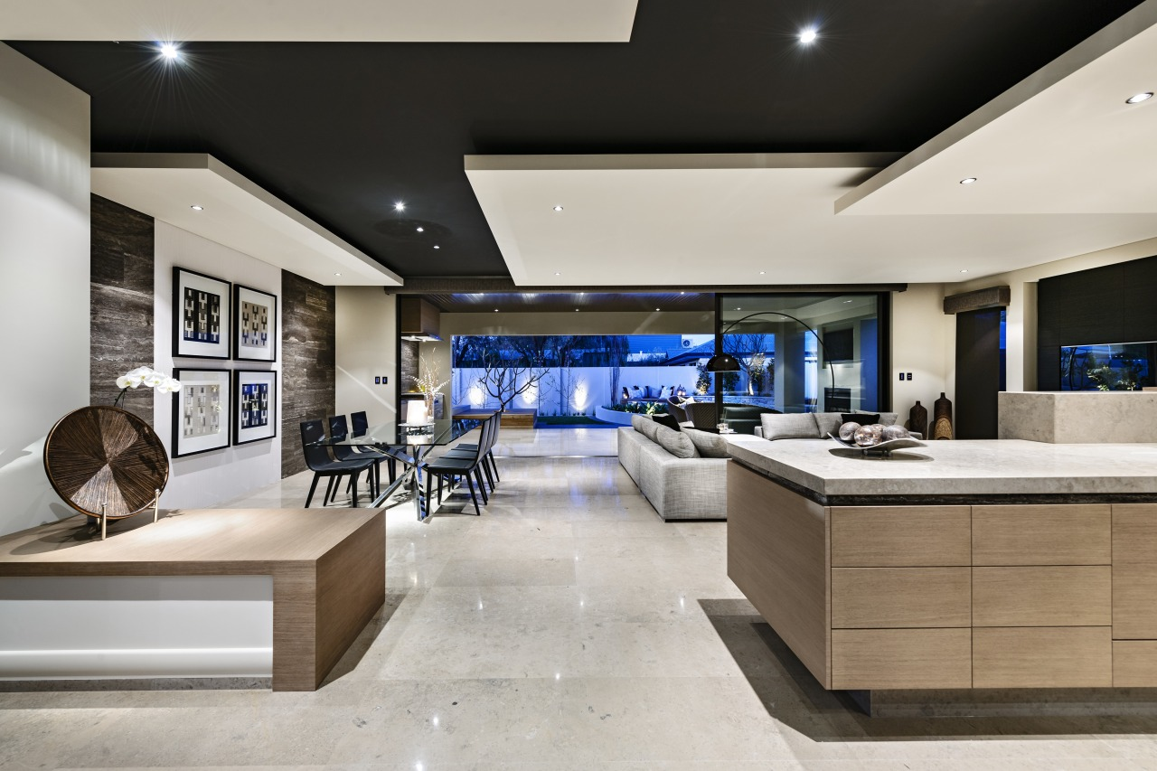 Living areas and kitchen are seamlessly integrated in interior design, kitchen, living room, gray, black