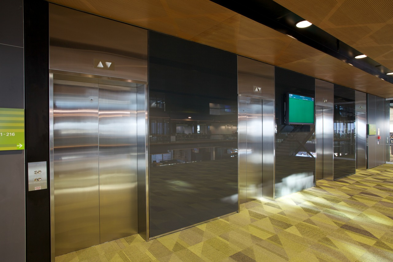 Elevators in the MIT Manukau campus are smooth architecture, floor, glass, interior design, lobby, wall, brown, black