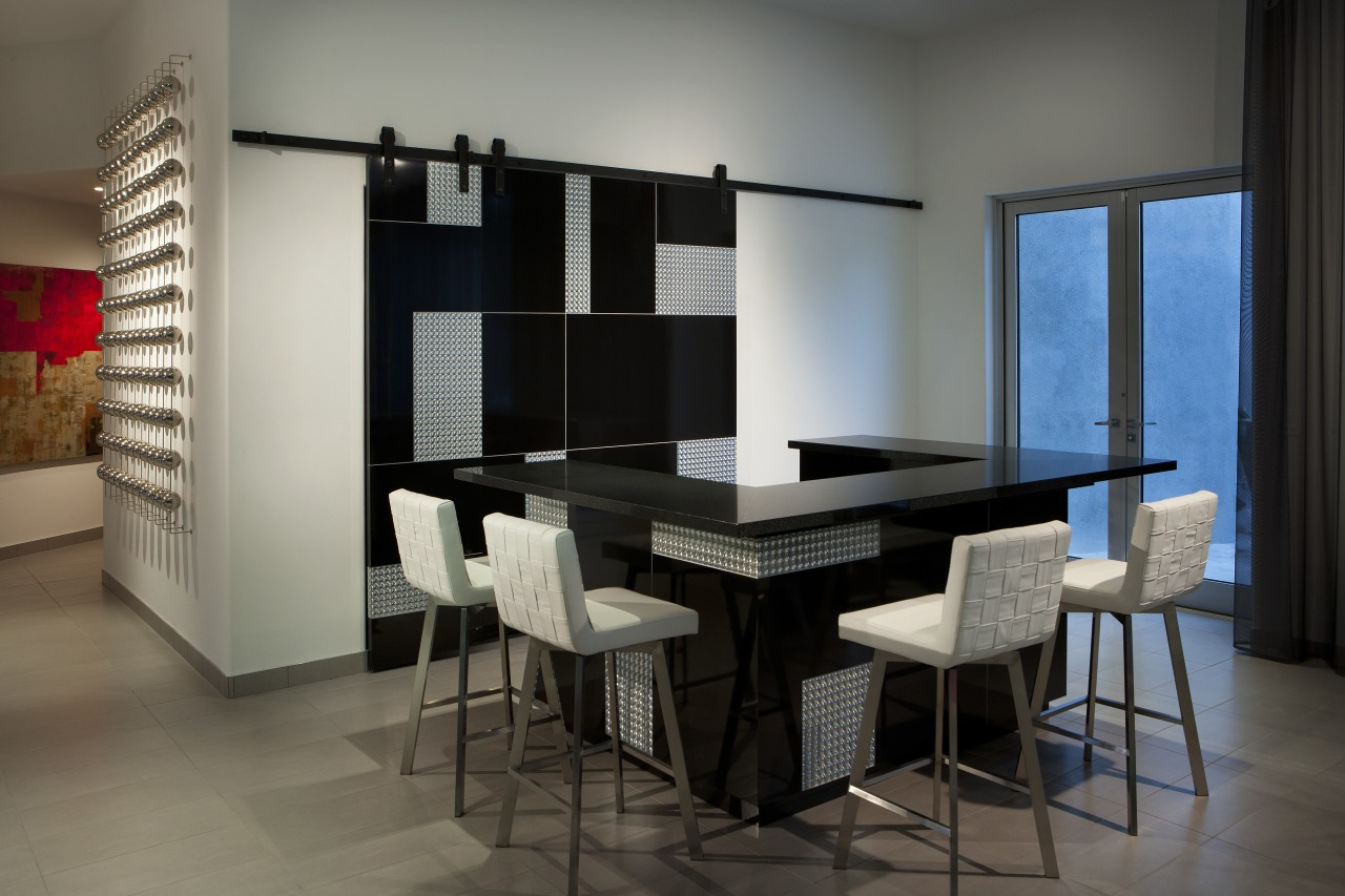 Sliding doors conceal part of this glittering bar dining room, furniture, interior design, room, table, gray, black