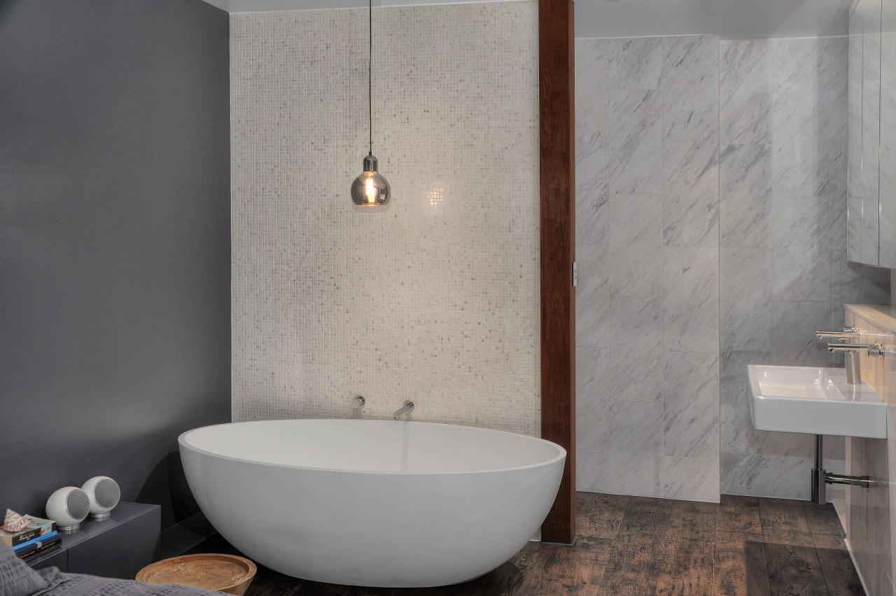 A mosaic blade wall hides the toilet and bathroom, bathroom sink, bidet, ceramic, floor, flooring, interior design, plumbing fixture, product design, room, sink, tap, tile, wall, gray