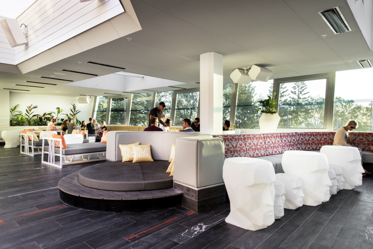This seaside entertainment venue features a covered outdoor furniture, interior design, lobby, white, gray