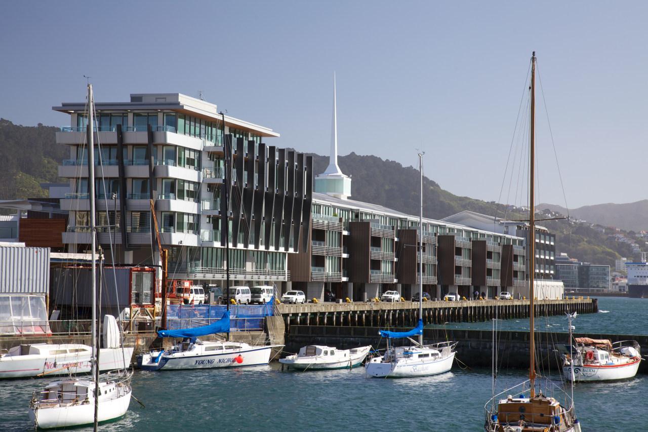 The design of the Clyde Quay Wharf development boat, building, city, condominium, dock, harbor, marina, port, sea, sky, water, water transportation, watercraft, teal