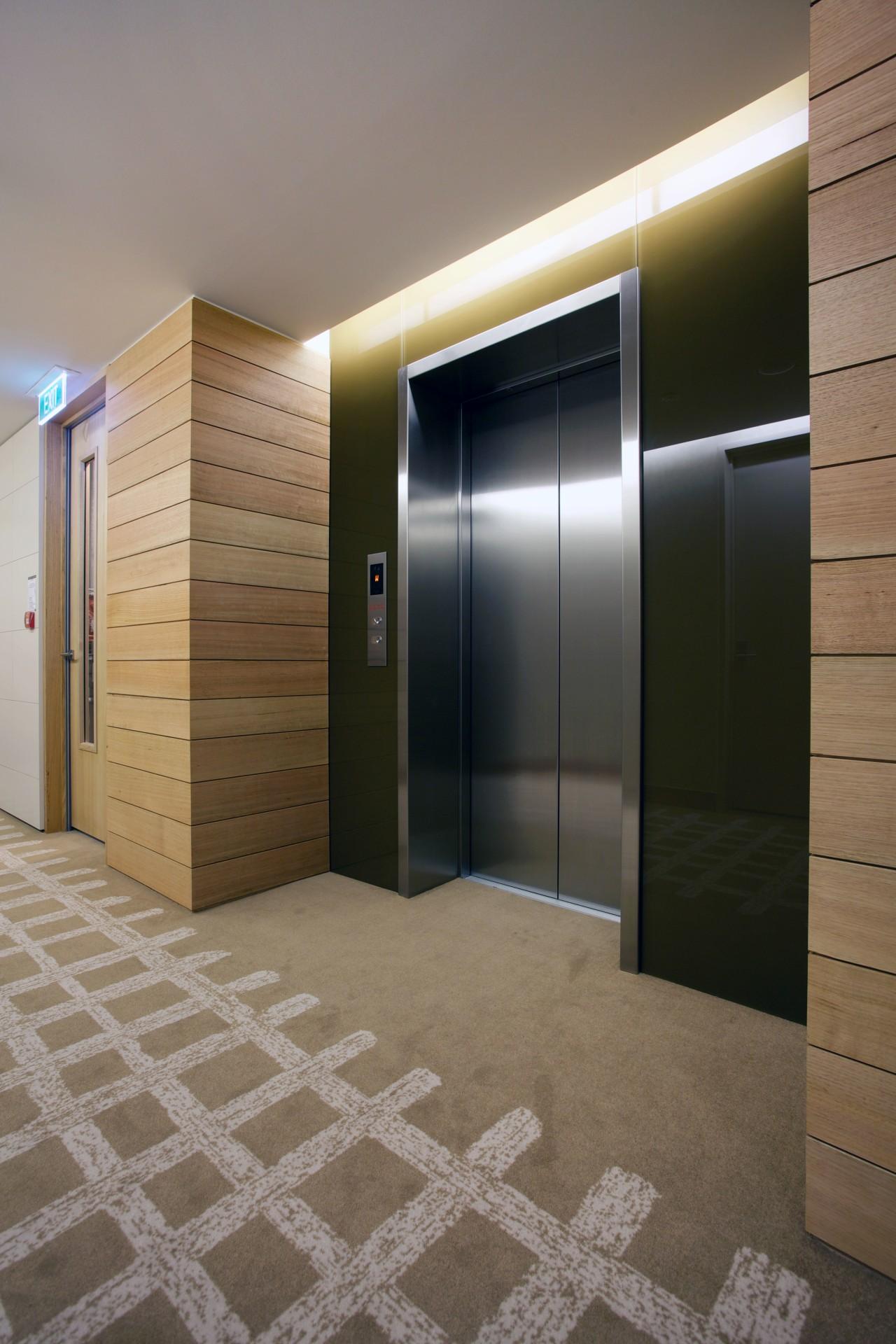 Otis Elevators supplied and maintains nine Otis Gen2 architecture, floor, flooring, interior design, lobby, real estate, brown, gray