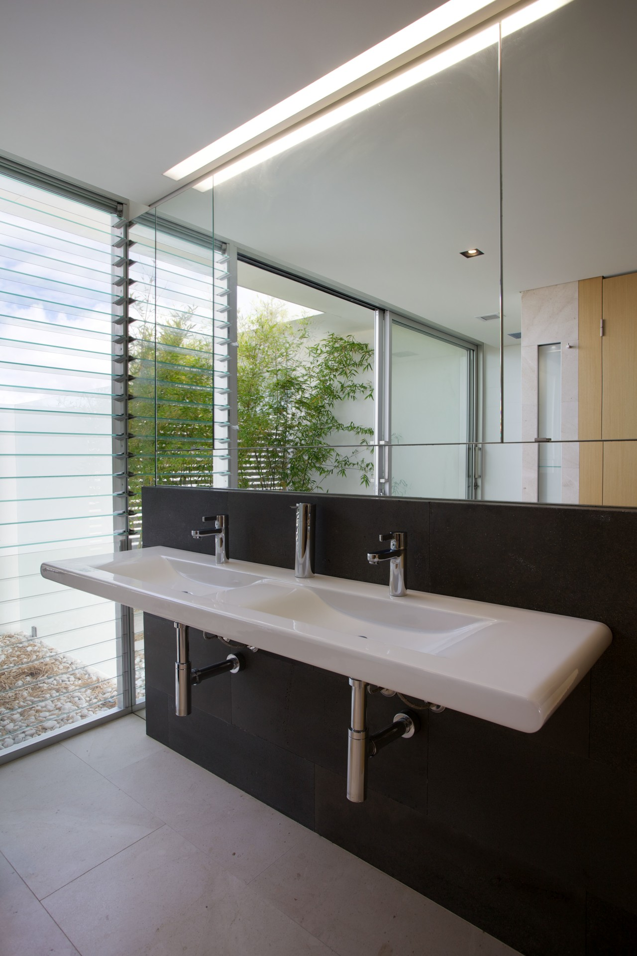The storage in this ensuite bathroom is on architecture, bathroom, daylighting, glass, house, interior design, sink, window, gray