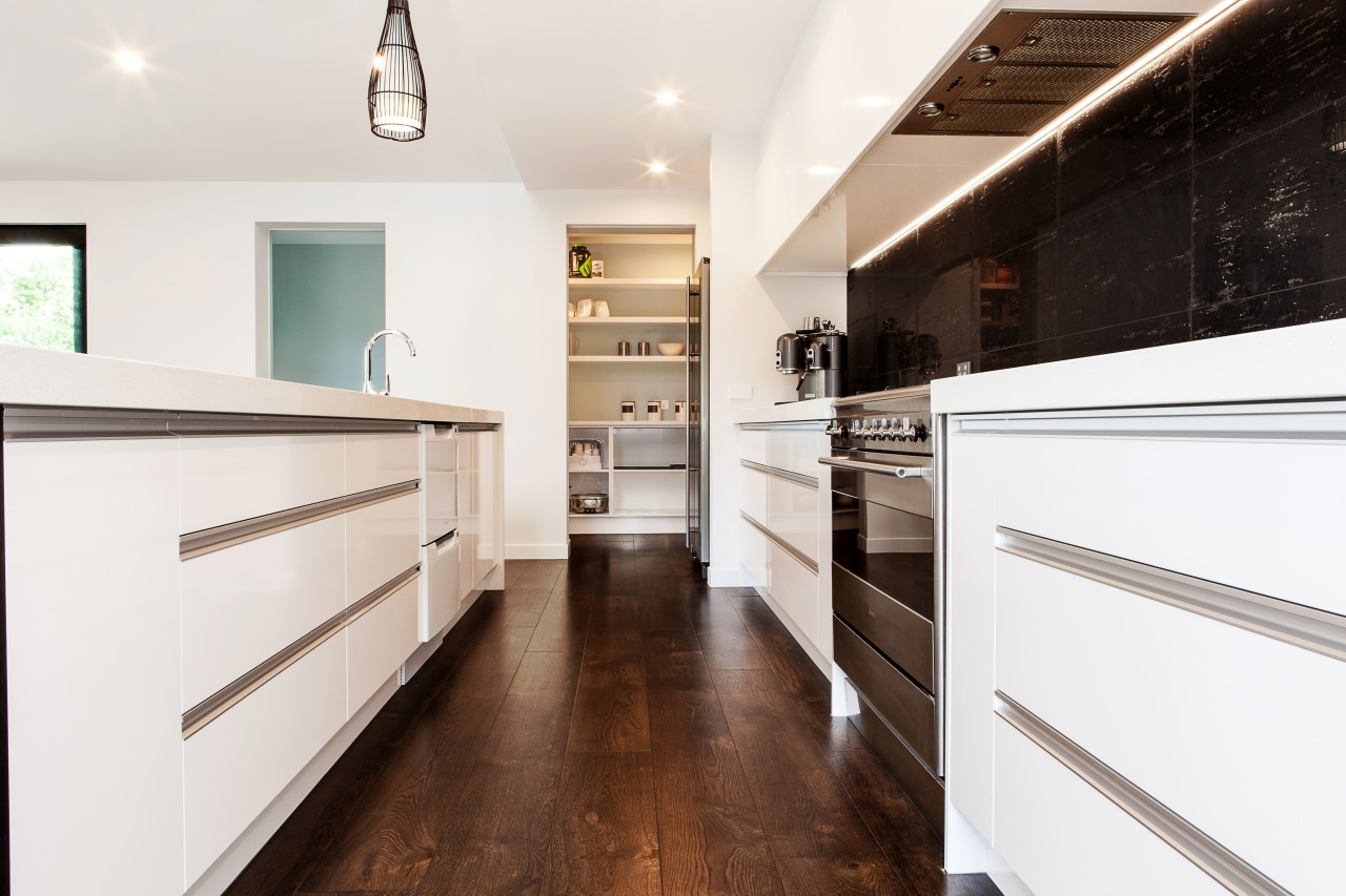 The benchtops in this new kitchen are in cabinetry, countertop, cuisine classique, floor, flooring, home, interior design, kitchen, room, white