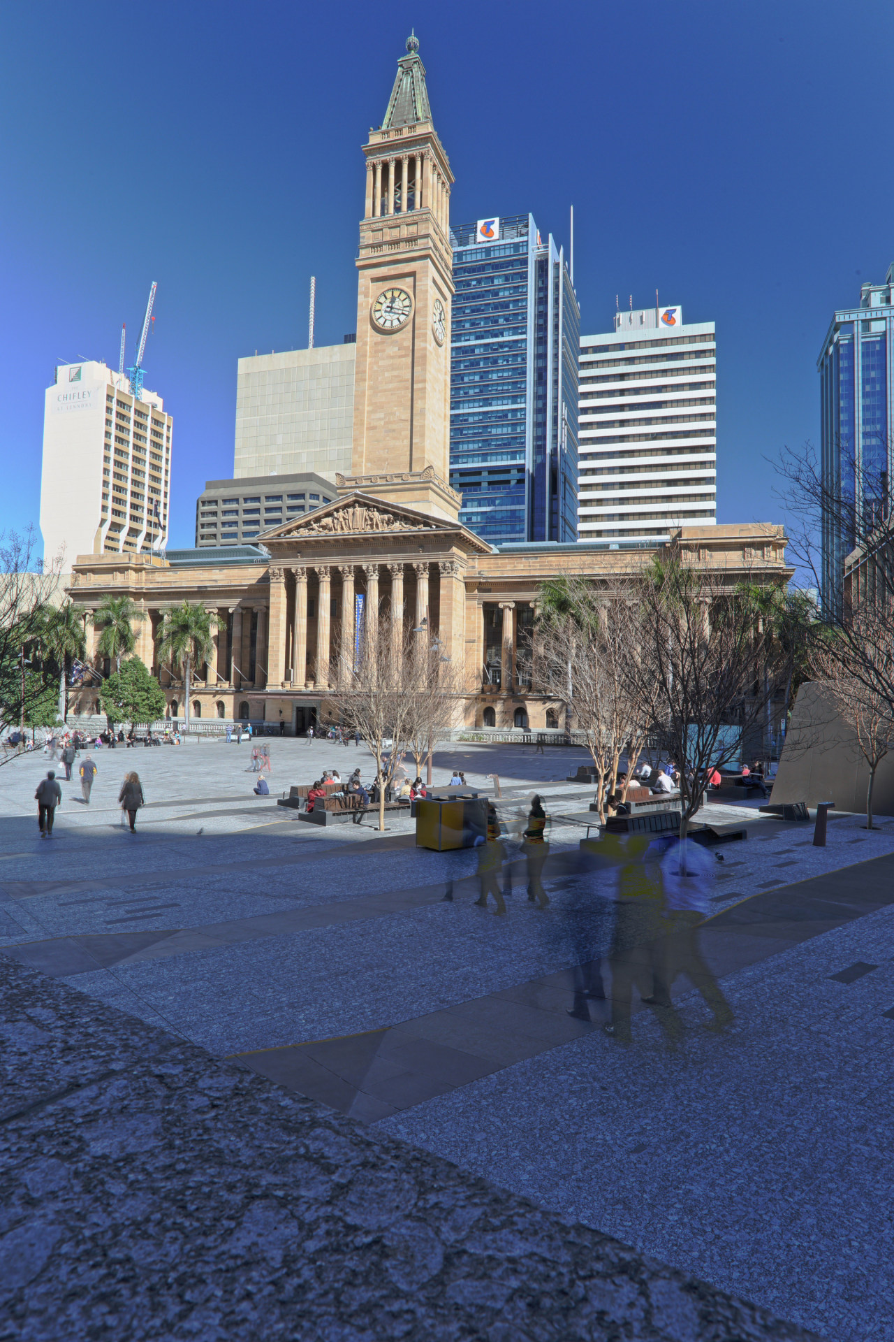 Brisbane City Hall has been restored and updated architecture, building, city, cityscape, daytime, downtown, landmark, metropolis, metropolitan area, plaza, reflection, sky, skyline, skyscraper, tourist attraction, tower, tower block, town square, tree, urban area, blue