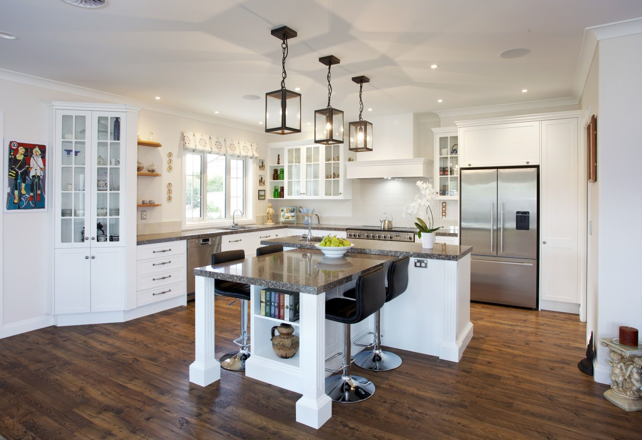 This high-end, traditional kitchen was produced by Mastercraft countertop, cuisine classique, floor, flooring, hardwood, interior design, kitchen, real estate, room, wood flooring, gray