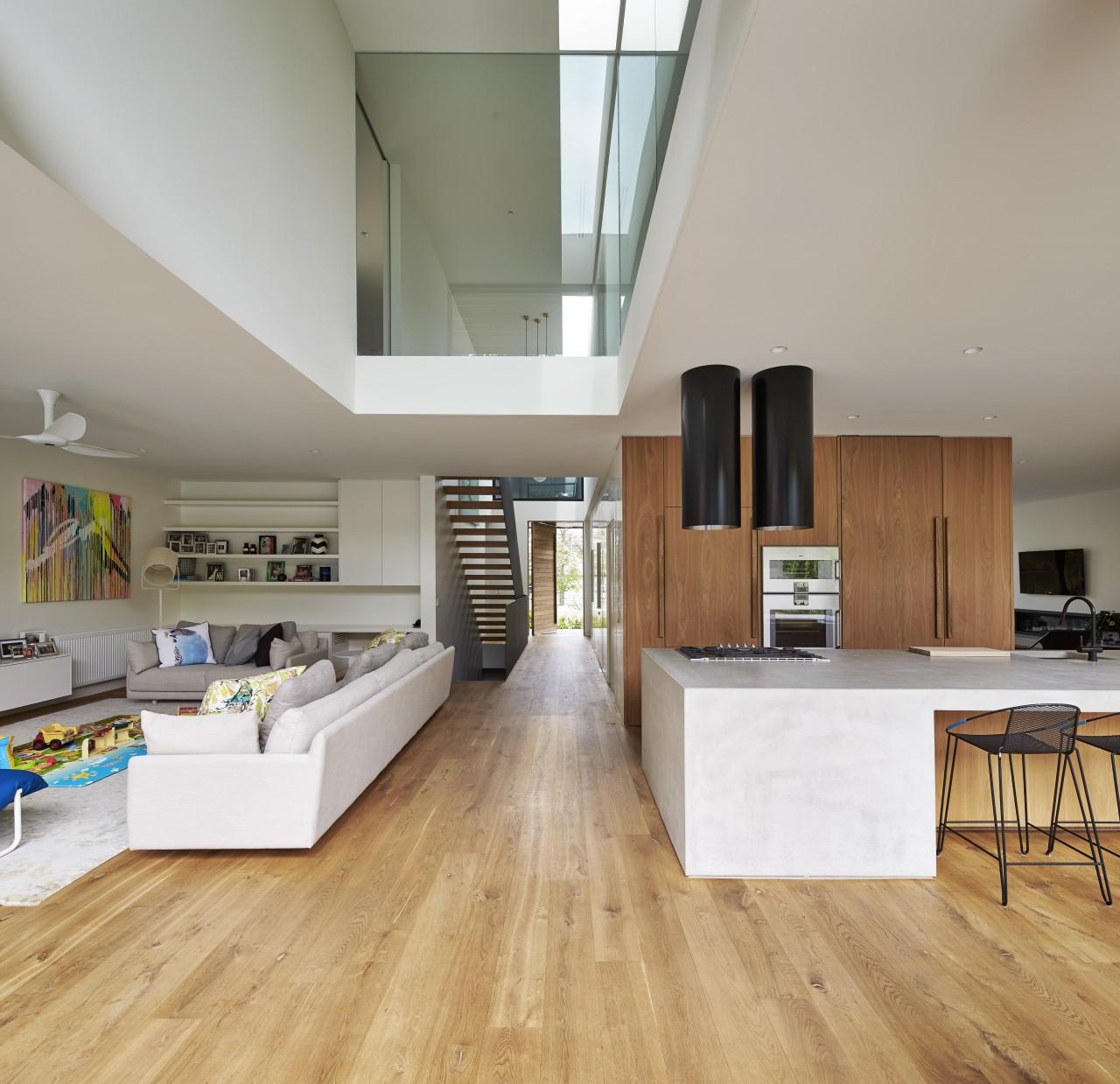 The family living area is on the left floor, flooring, hardwood, interior design, kitchen, laminate flooring, living room, wood, wood flooring, gray