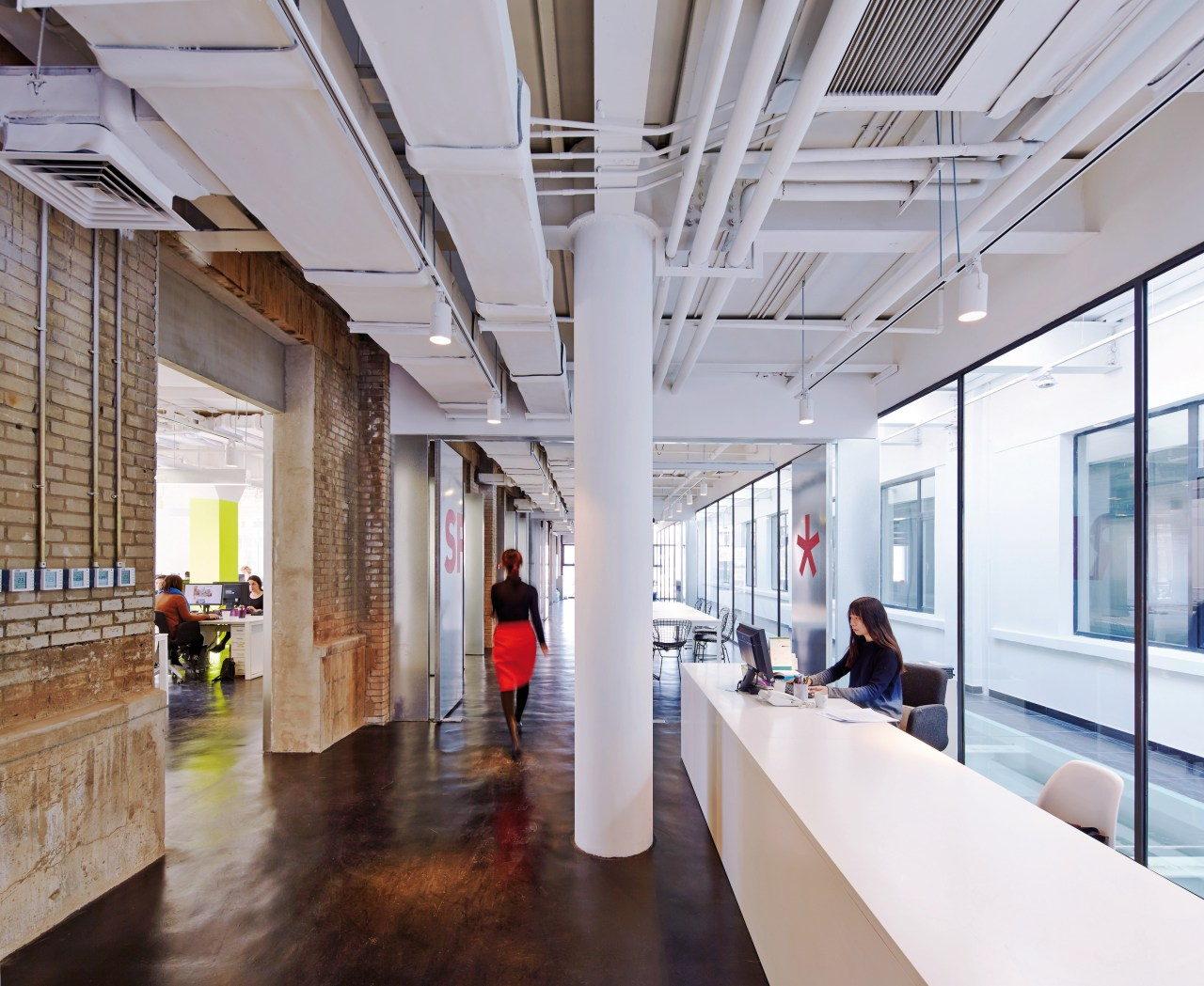 Exposed brick walls and service ducts provide an architecture, ceiling, interior design, lobby, gray