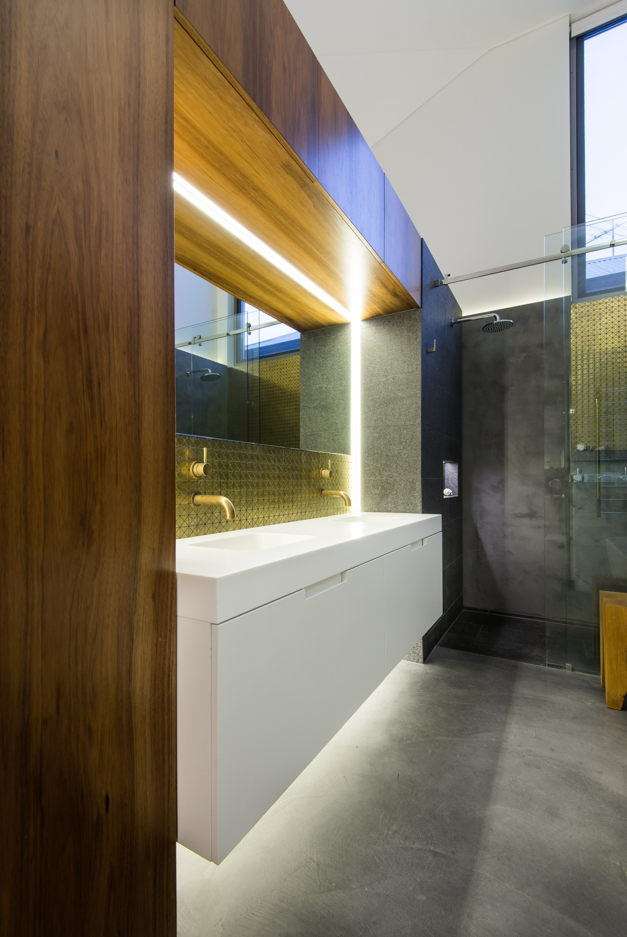 The white floating vanity is underlit, adding to architecture, floor, house, interior design, gray, brown