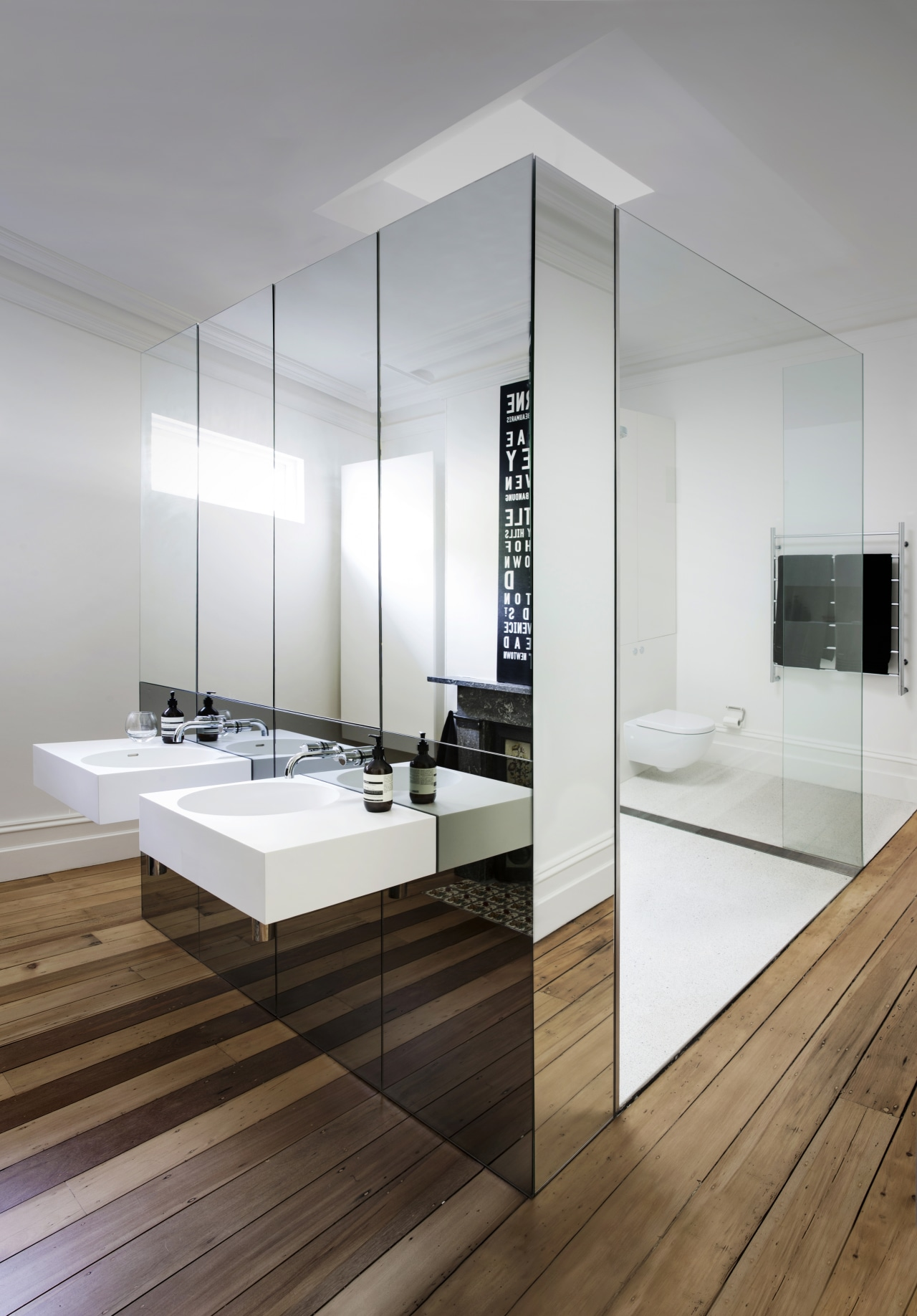 This floating vanity's use of mirrors plays up bathroom, floor, interior design, sink, white, gray