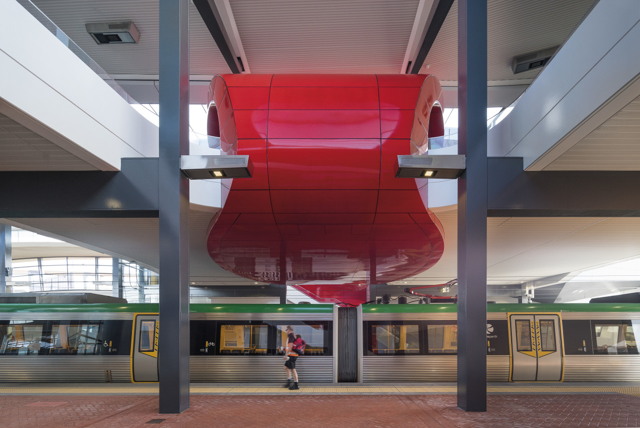 A curved, bright red interior canopy frames the architecture, daylighting, metropolitan area, structure, gray