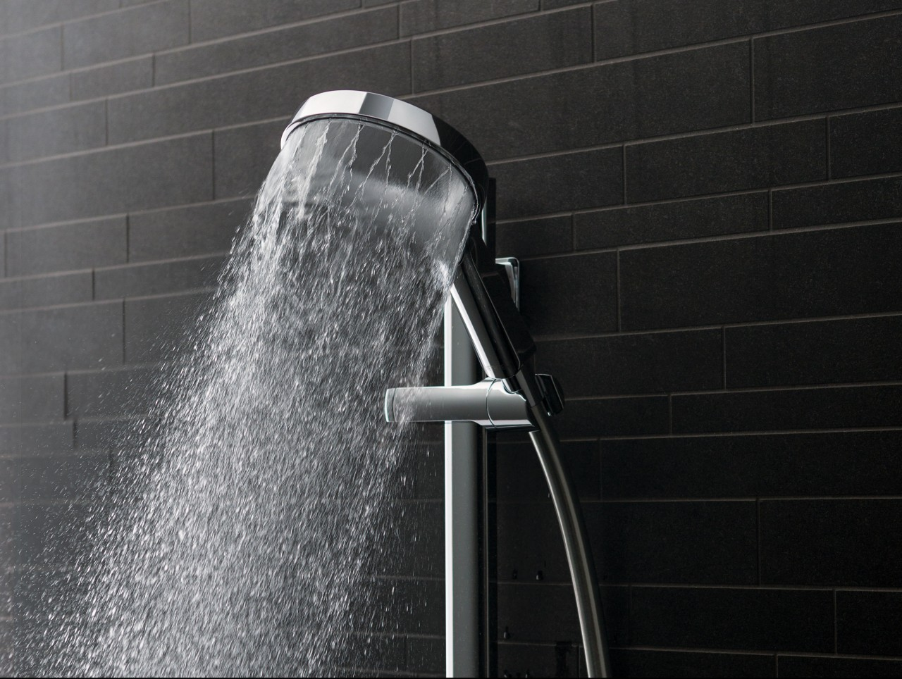 The new Aurajet showerhead offers improved spray coverage black, black and white, monochrome, monochrome photography, plumbing fixture, water, black, gray