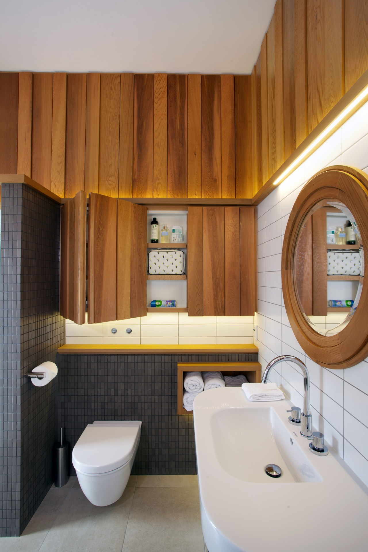 Oiled western red cedar shiplap wraps around the architecture, bathroom, home, interior design, plumbing fixture, room, toilet, gray, brown