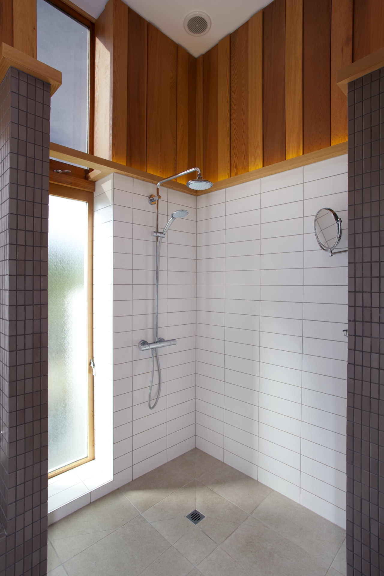 There is extensive uplighting in this remodelled bathroom, architecture, bathroom, ceiling, daylighting, floor, flooring, home, house, interior design, plumbing fixture, property, room, tile, wall, gray