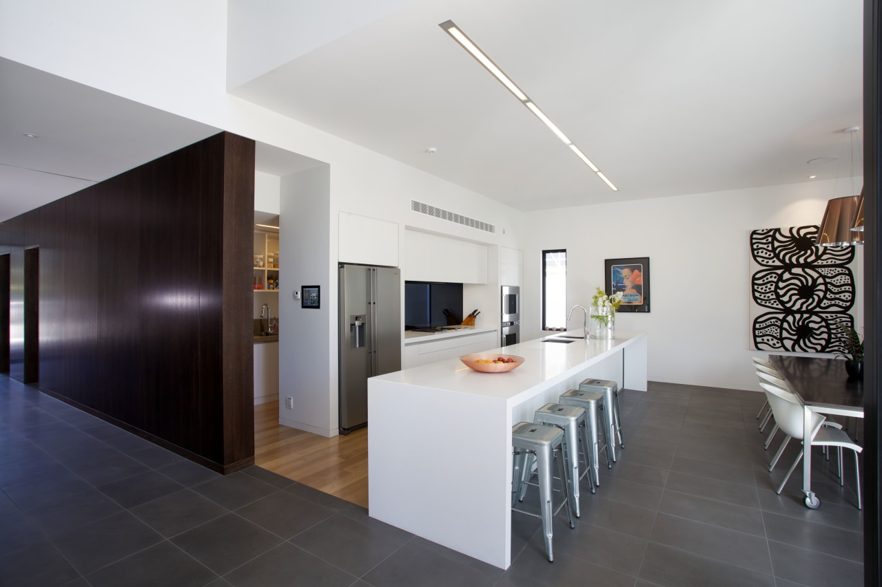 Seperate flooring materials define the kitchen work space. architecture, ceiling, floor, house, interior design, kitchen, property, real estate, room, gray, black