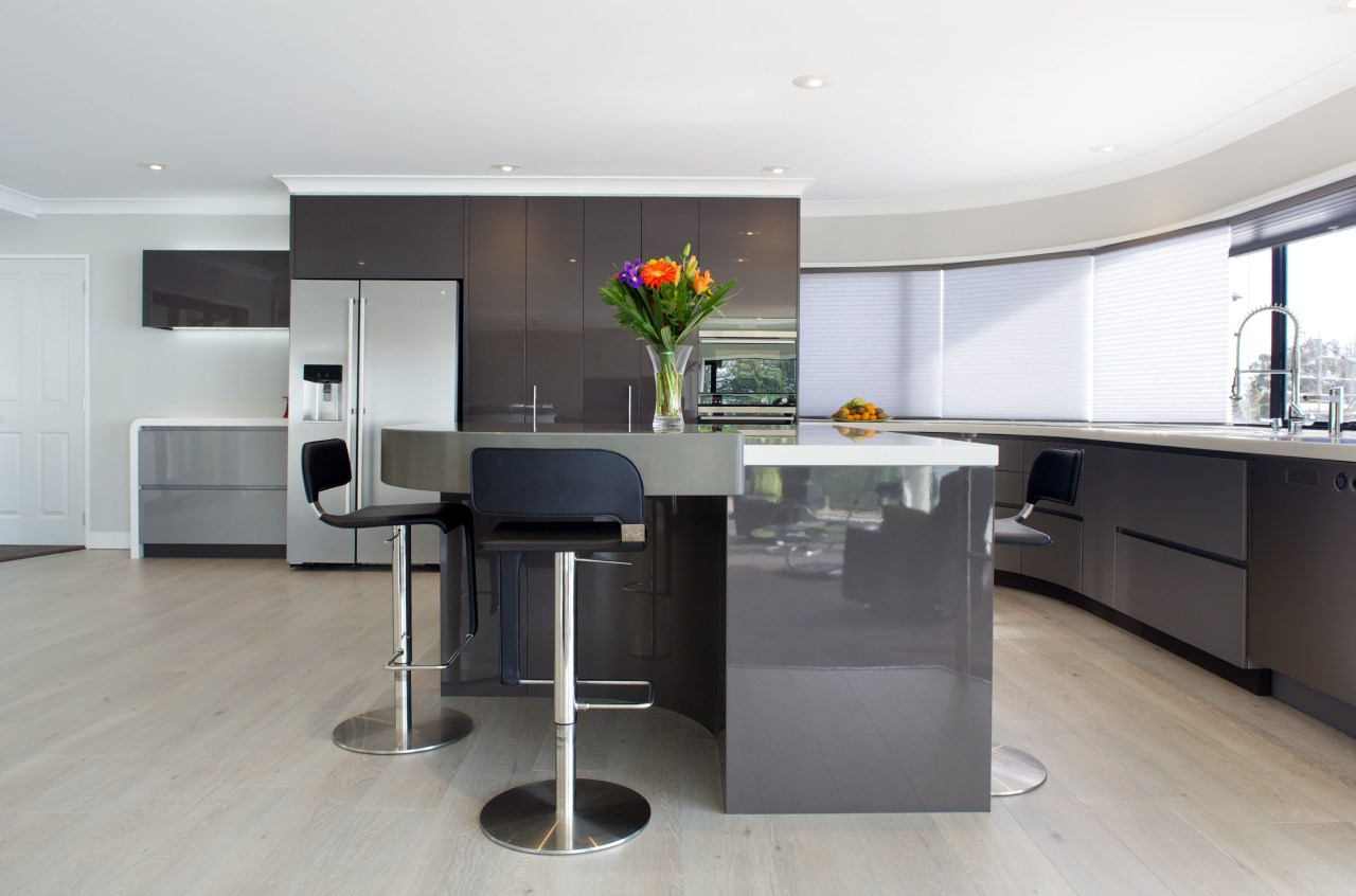 High-gloss metallic lacquered cabinetry features in this new countertop, floor, interior design, kitchen, product design, gray, white