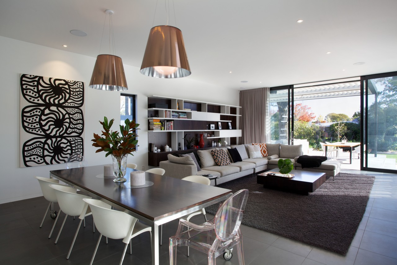 Theres an easy indoor-outdoor flow to this family ceiling, house, interior design, living room, real estate, room, table, gray