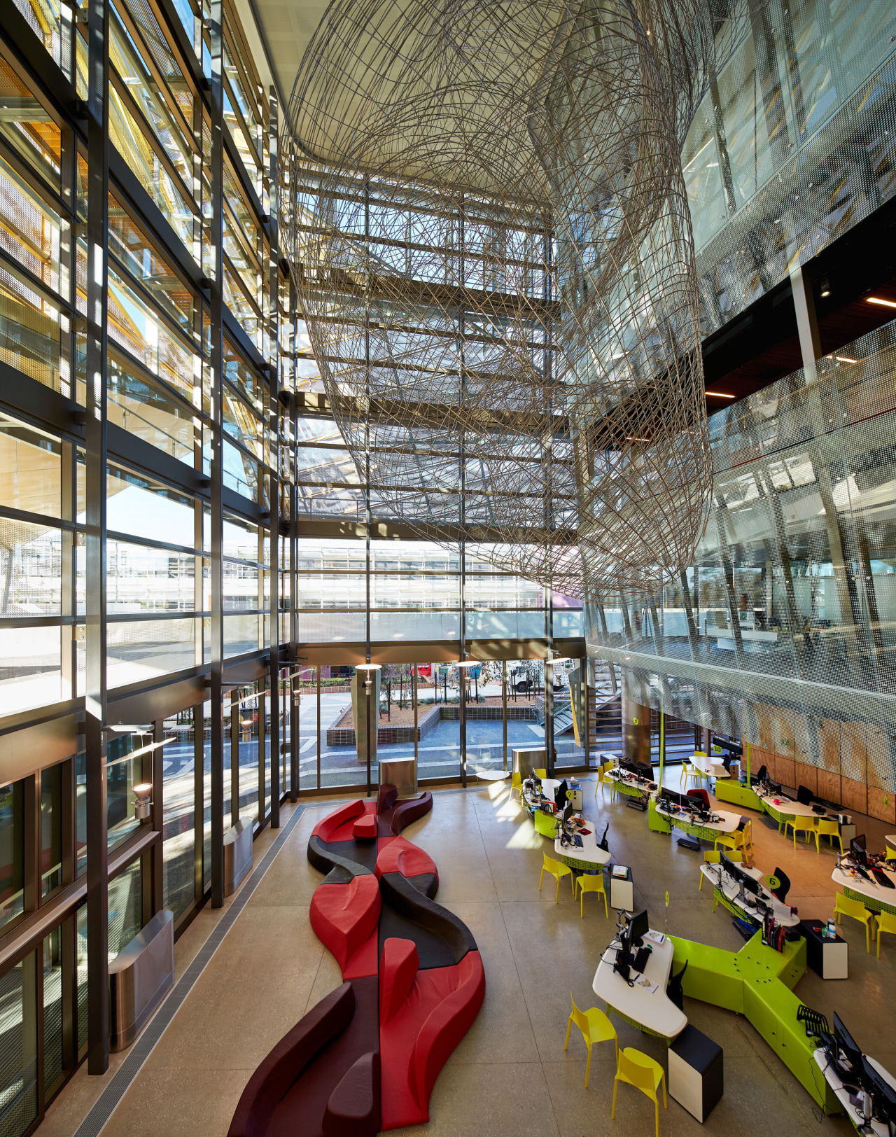 A grand atrium forms a vertical spine on architecture, building, daylighting, institution, interior design, lobby, mixed use, brown
