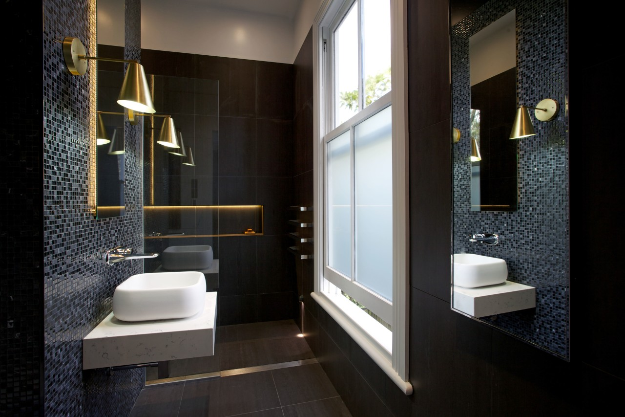 LED lights tucked behind the vanity mirror and architecture, bathroom, floor, interior design, room, black
