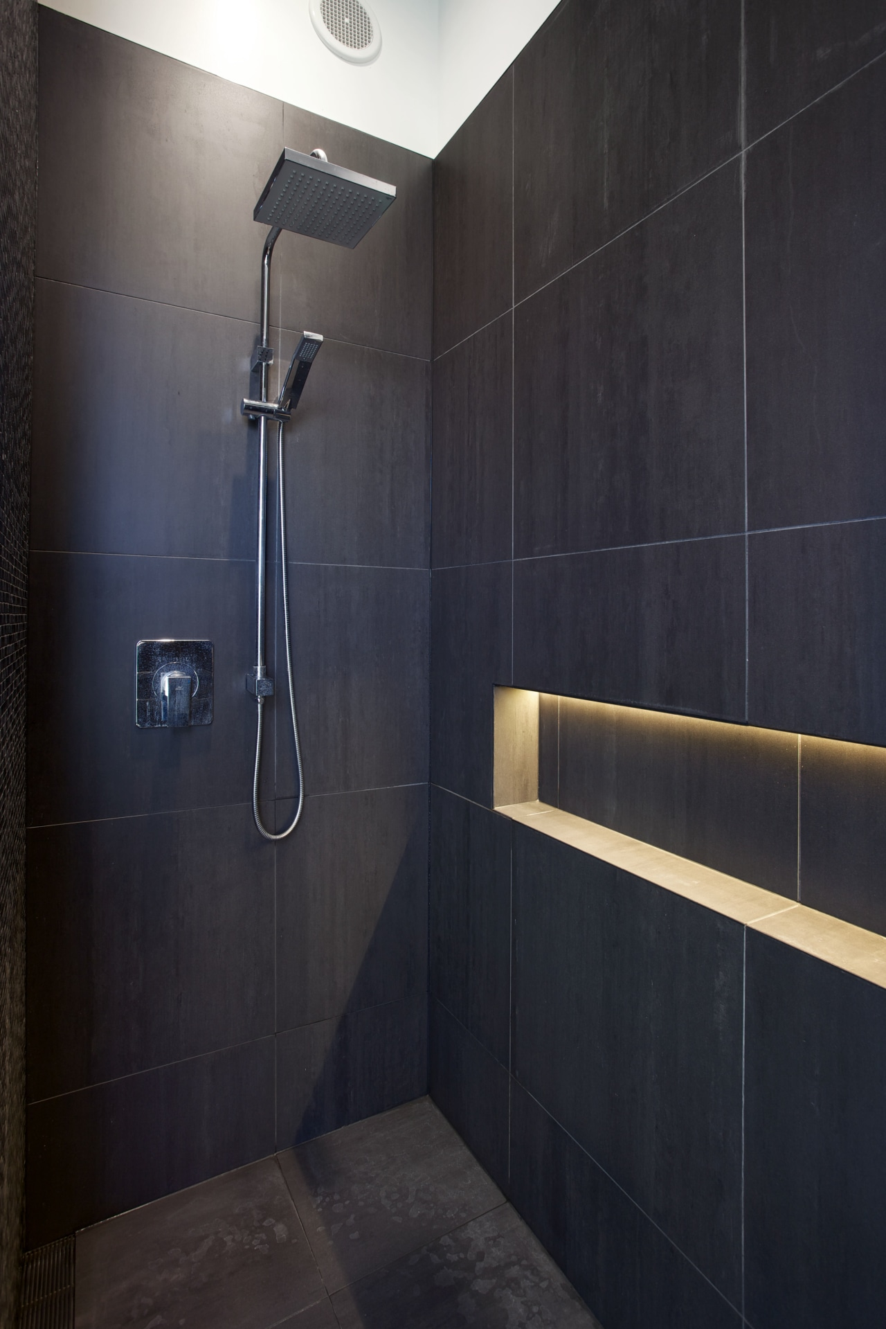 With the right lighting, you can make your architecture, bathroom, floor, interior design, light, lighting, plumbing fixture, room, shower, tile, wall, black
