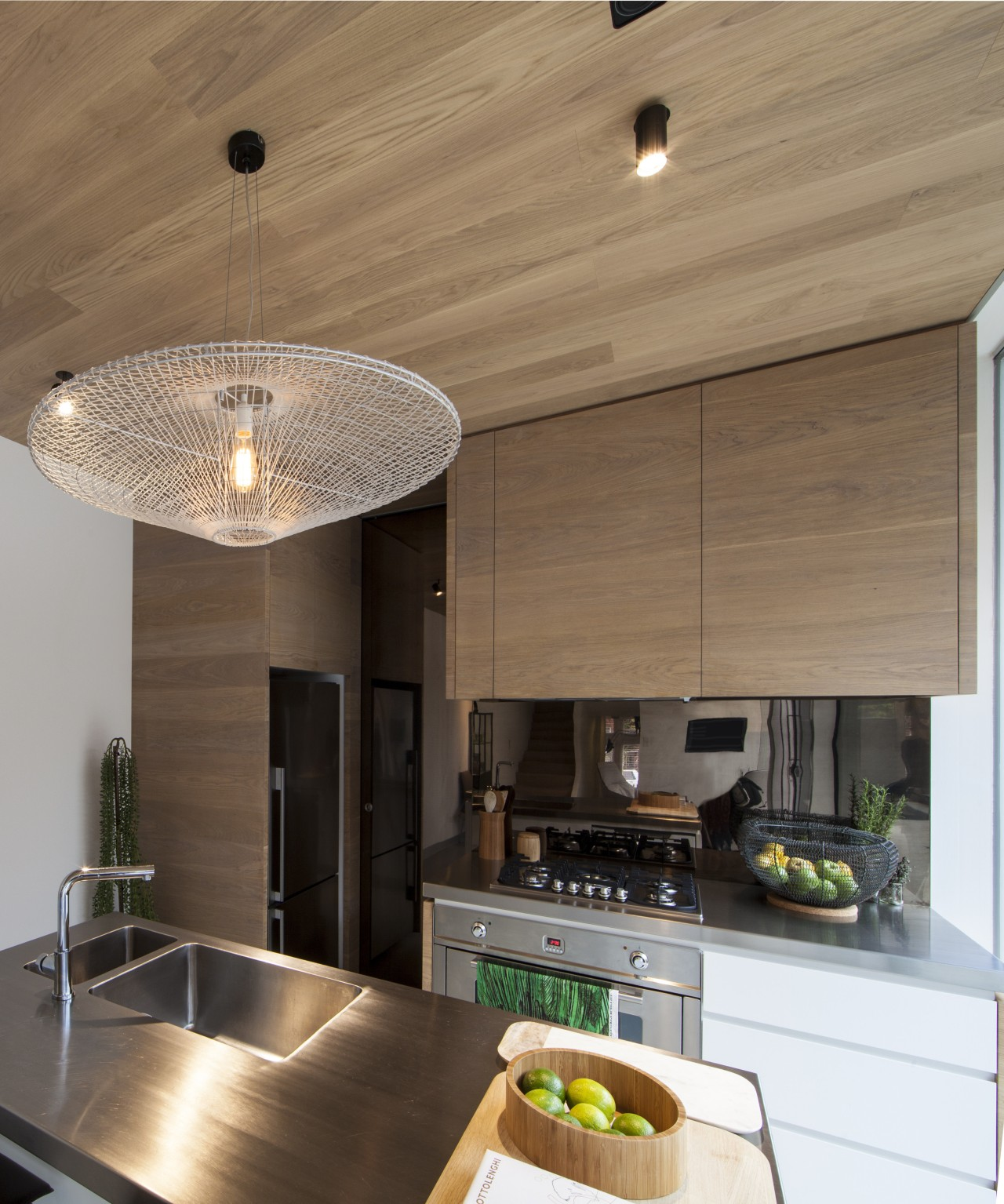 This kitchens pantry is concealed behind a shiny architecture, ceiling, countertop, cuisine classique, interior design, kitchen, light fixture, real estate, brown
