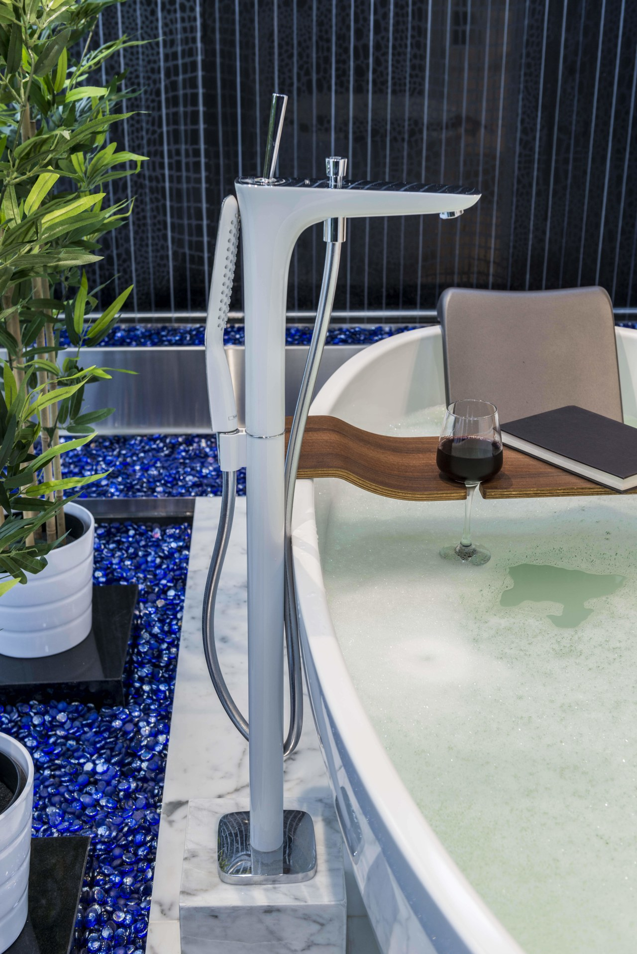 Blue glass pebbles were introduced at the base bathtub, plumbing fixture, swimming pool, water, gray, black