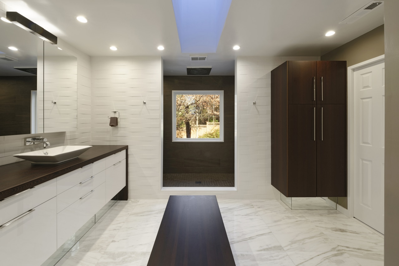 A skylight and indirect lighting from three sconces cabinetry, countertop, floor, flooring, interior design, kitchen, room, wood flooring, gray