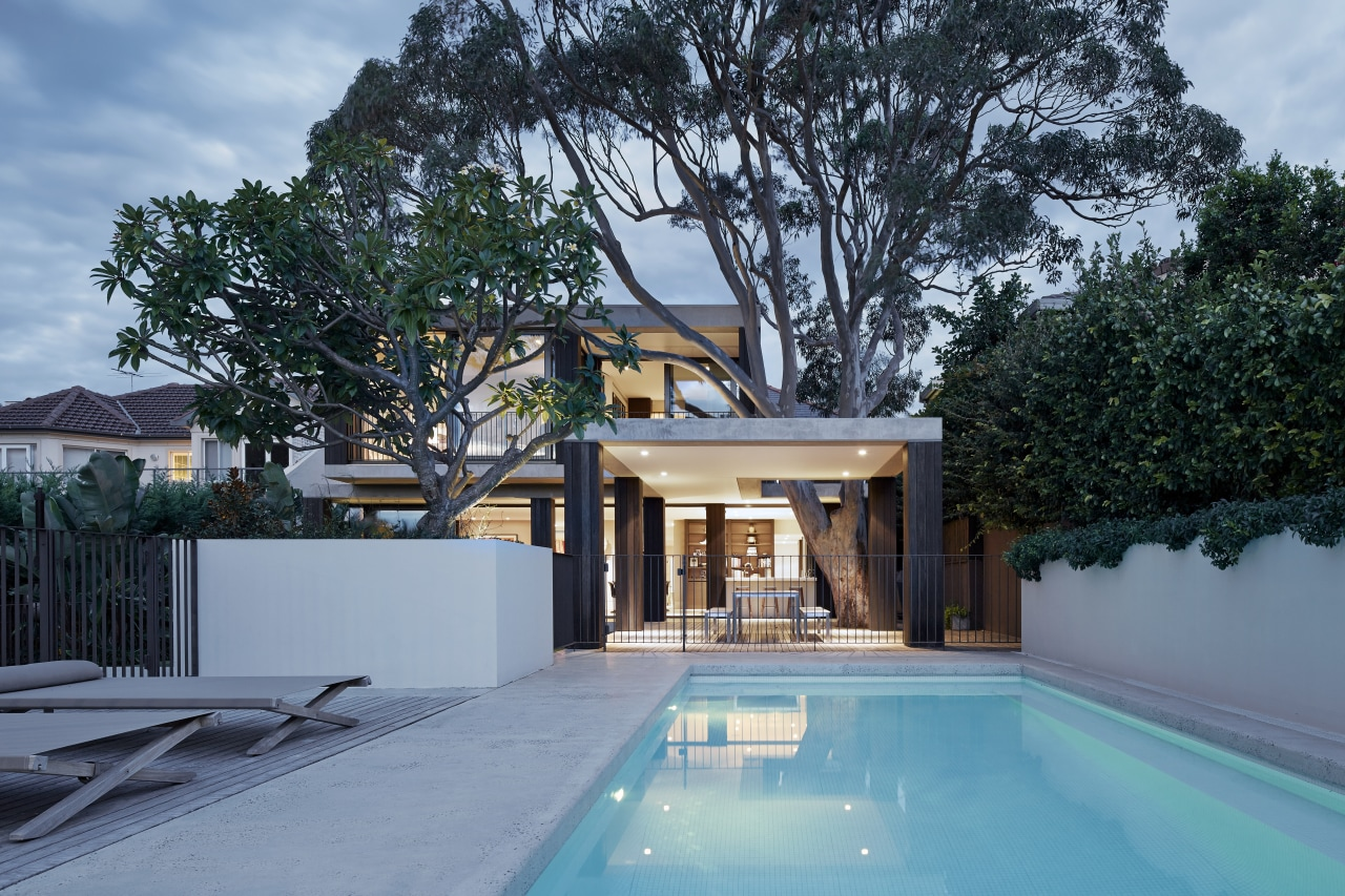 Offering a point of difference to the solidity architecture, backyard, cottage, estate, home, house, property, real estate, residential area, resort, swimming pool, tree, villa, teal, black