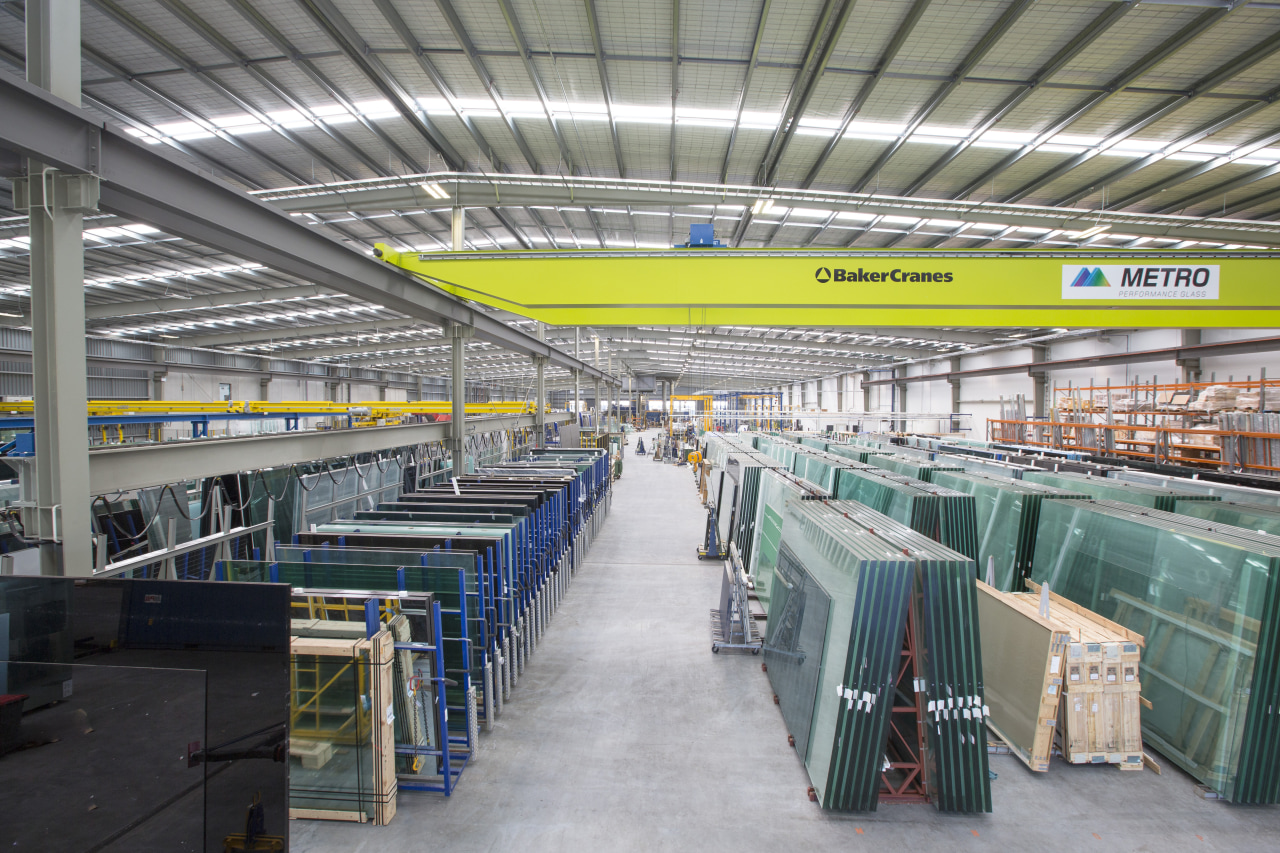 The new Metro Performance Glass manufacturing facility is airport terminal, factory, industry, manufacturing, mass production, steel, warehouse, gray