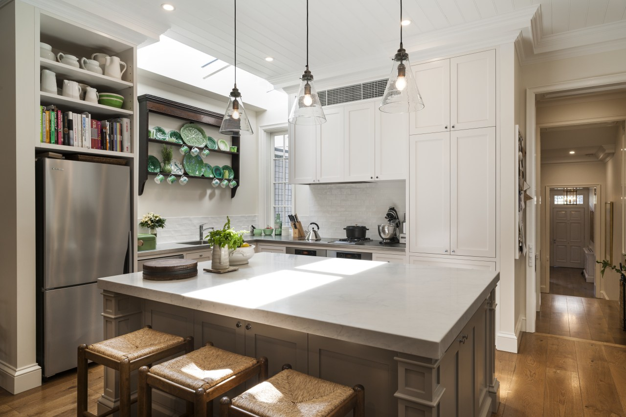 A furniture-like island with corner detailing and a cabinetry, countertop, cuisine classique, interior design, kitchen, real estate, room, gray, brown