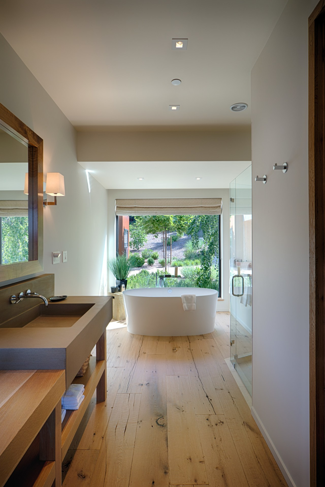 This bathroom shows the more contemporary feel that architecture, ceiling, daylighting, floor, flooring, hardwood, home, house, interior design, living room, real estate, room, window, wood flooring, gray, brown