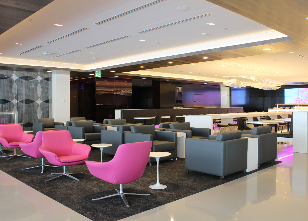 A custom chandelier evokes the land of the ceiling, conference hall, furniture, interior design, lobby, office, gray, black