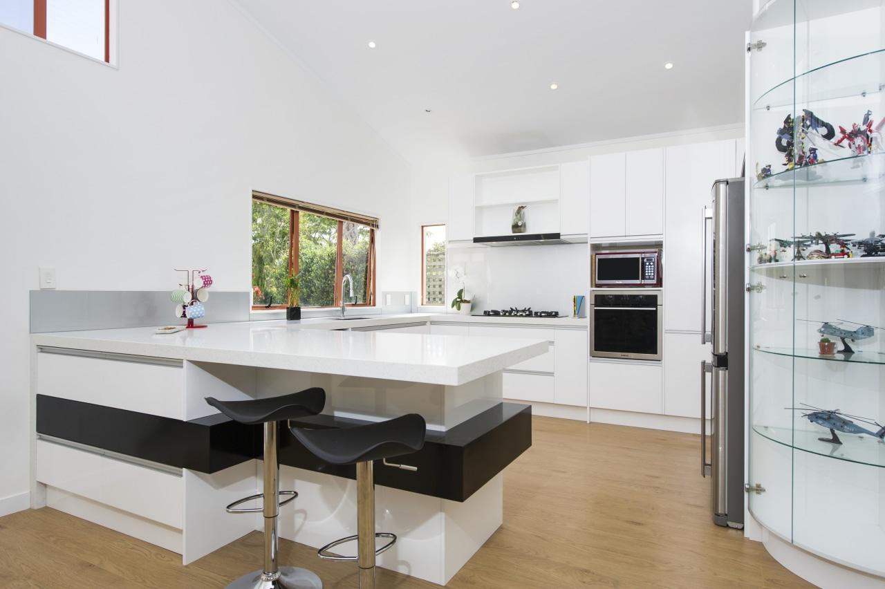 This crisp, contemporary white kitchen was designed and countertop, interior design, kitchen, room, white
