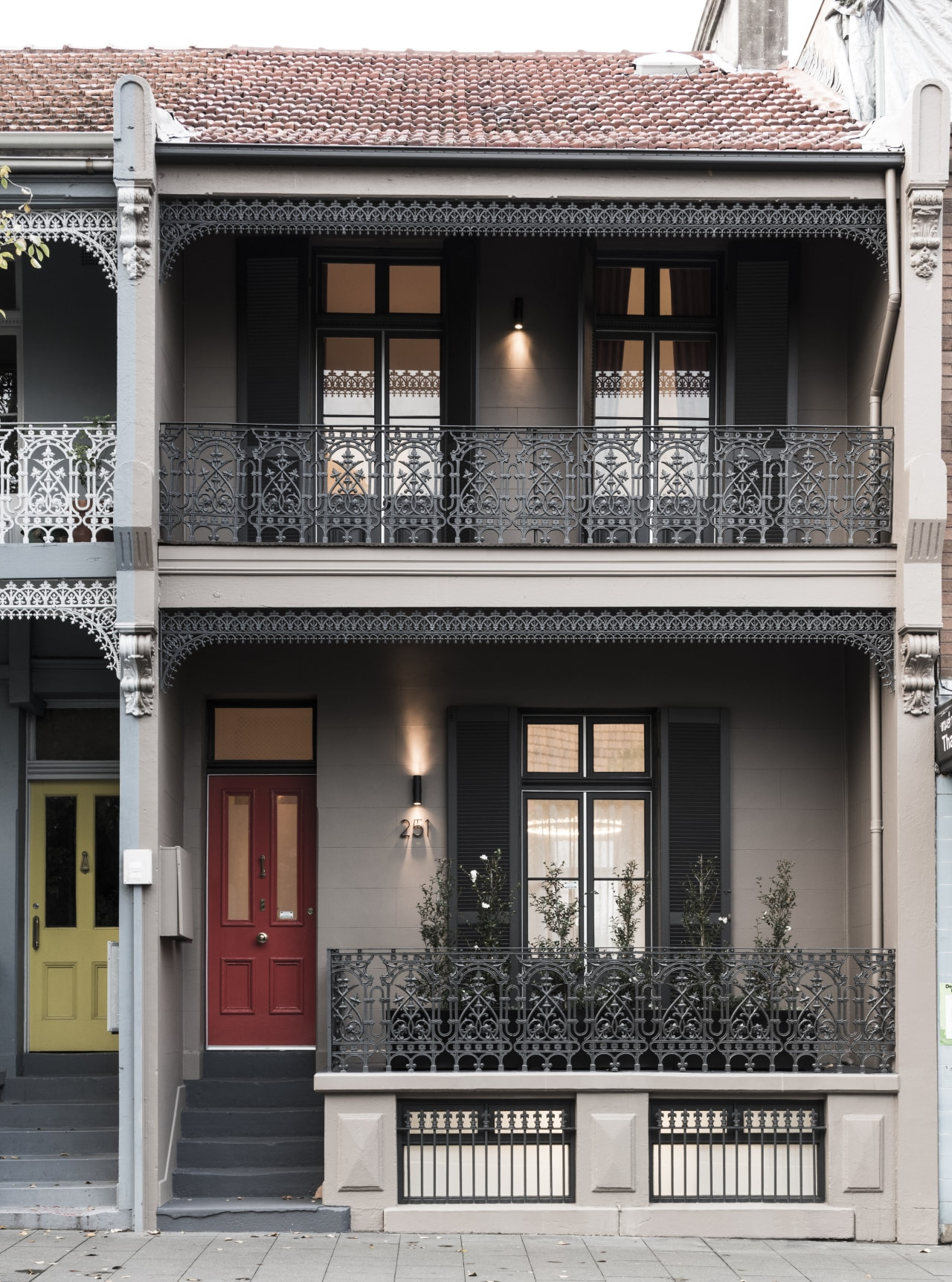 The freshly restored, elegant facade on this house architecture, balcony, building, door, facade, home, house, neighbourhood, property, real estate, residential area, window, black, white
