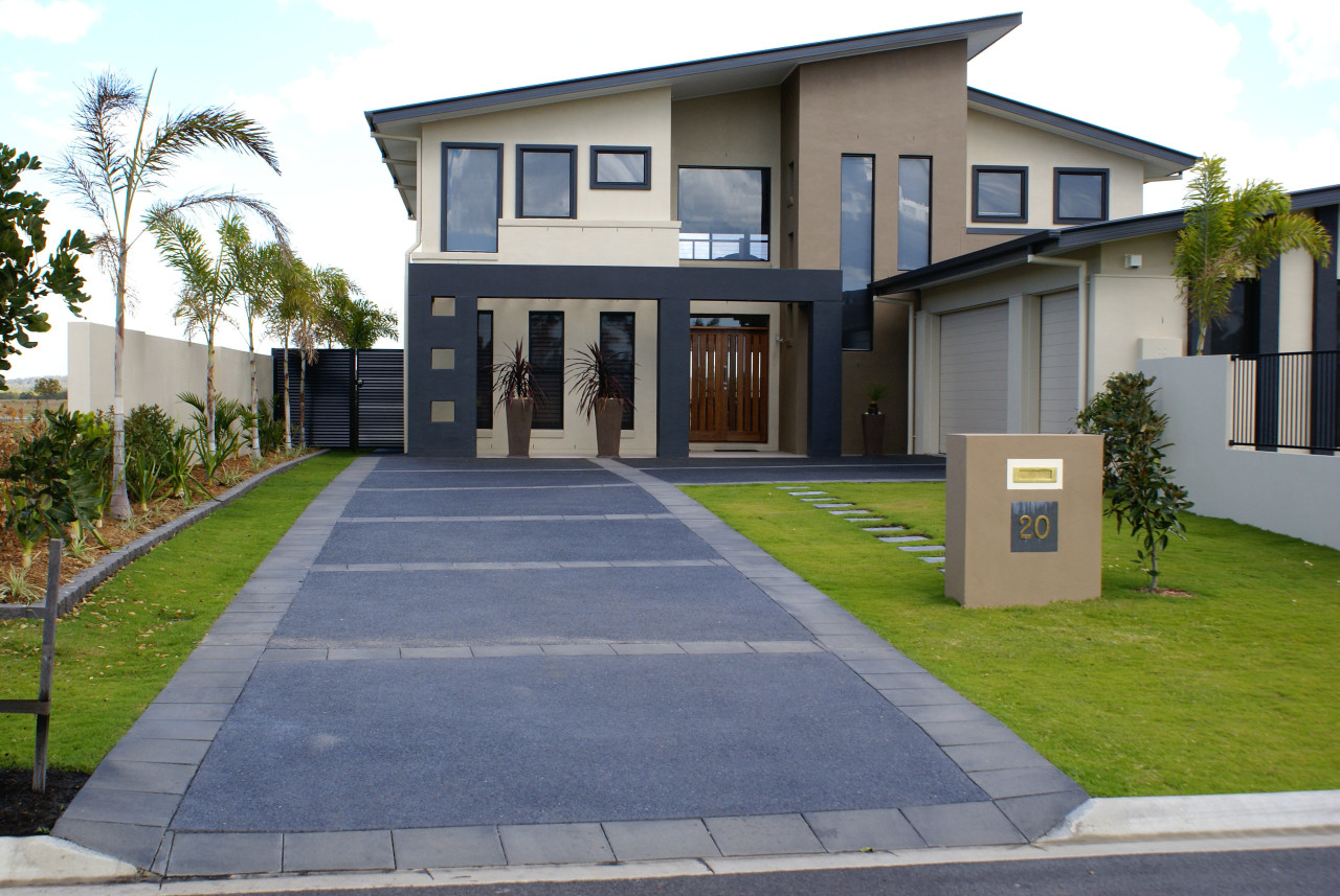This exposed aggregate concrete driveway was created by building, driveway, elevation, estate, facade, home, house, neighbourhood, official residence, property, real estate, residential area, walkway, gray