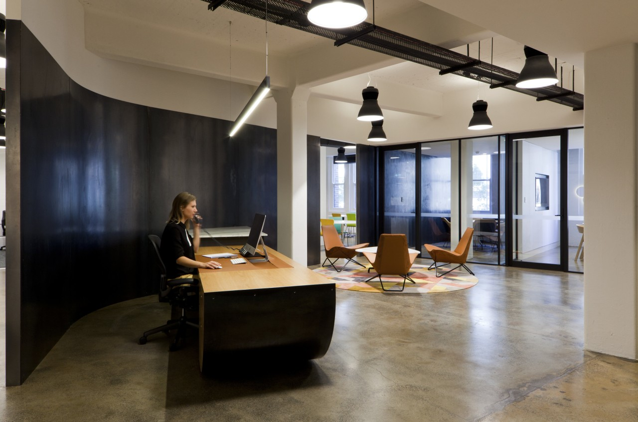 In this fit-out at Tanner Kibble Denton Architectss floor, flooring, furniture, interior design, loft, office, table, brown, black, gray