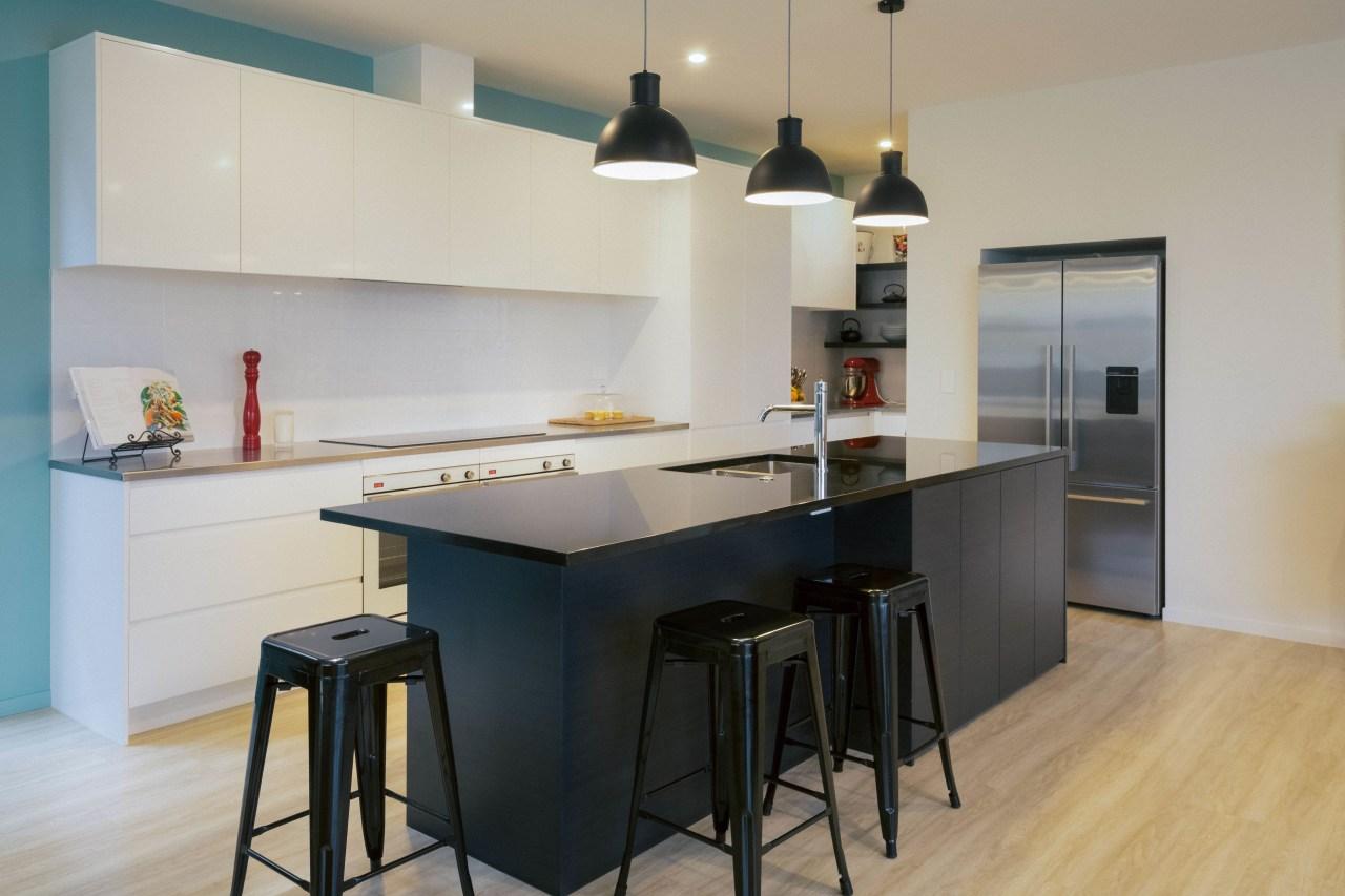 Apollo Kitchen and Bathroom creates dramatic, contemporary kitchens cabinetry, countertop, cuisine classique, floor, flooring, interior design, kitchen, real estate, room, wood flooring, gray