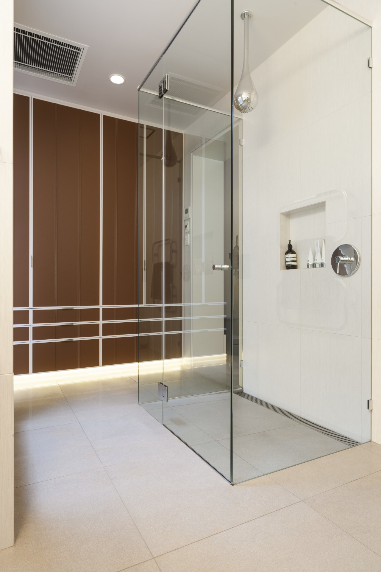 A Goccia showerhead provides variable showering experiences in floor, glass, interior design, plumbing fixture, shower, gray