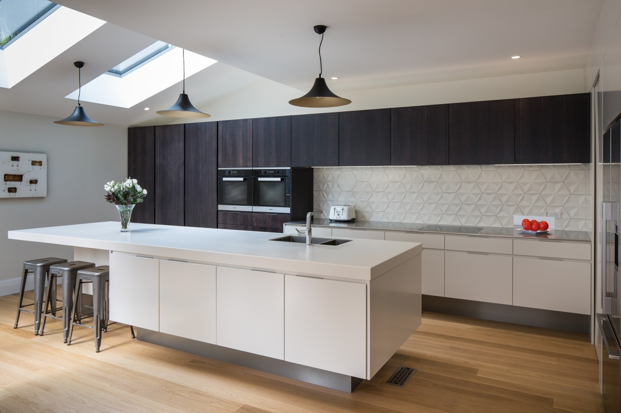 This airy kitchen by designer Pauline Stockwell offers cabinetry, countertop, cuisine classique, floor, interior design, kitchen, room, wood flooring, gray