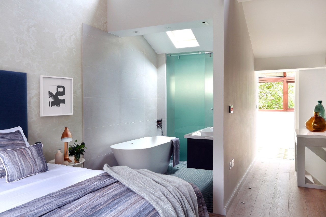 This whole-house renovation included creating a brand new architecture, bedroom, ceiling, floor, home, house, interior design, real estate, room, wall, gray