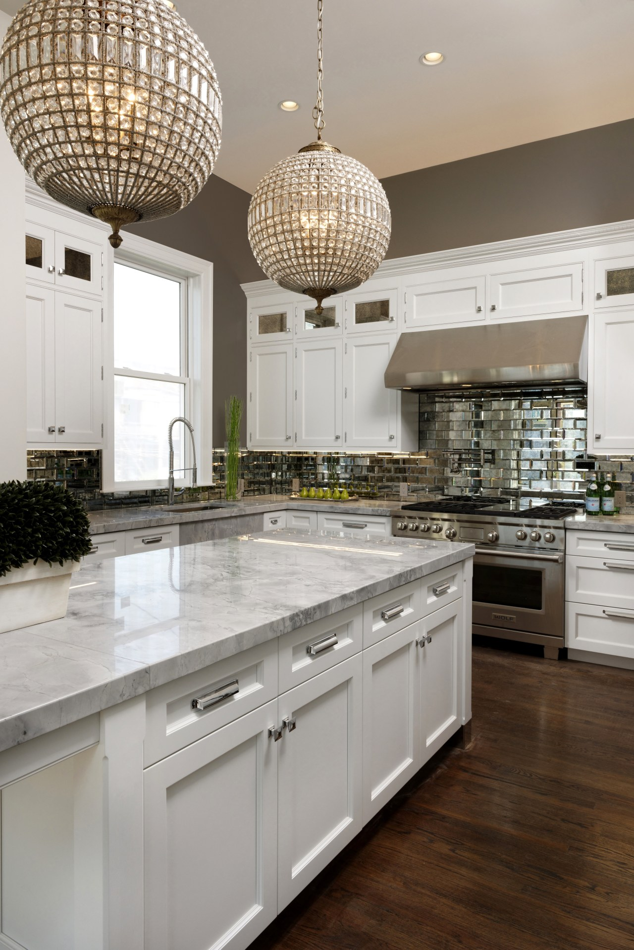This centrally placed island includes a wealth of cabinetry, countertop, cuisine classique, interior design, kitchen, room, gray, brown